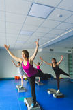 Two young woman and little girl doing gymnastic exercises. Instructor or Mother with daughter doing gymnastic exercises Stock Photography
