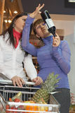 Two young woman looking vine Stock Image