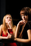 Two young woman in a night bar Royalty Free Stock Photos