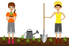 Two young woman plant nursery transplant in soil Stock Photos