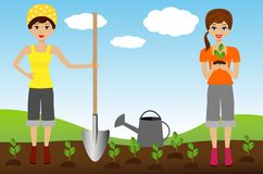 Two young woman plant nursery transplant in soil Royalty Free Stock Images