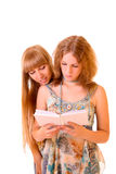 Two young woman reading book isolated Stock Image