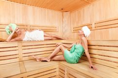 Two young woman relaxing in sauna Royalty Free Stock Image