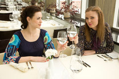 Two young woman  in the restaurant Royalty Free Stock Image