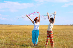 Two young woman with ribbons Stock Image