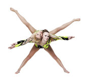 Two young woman show high gymnastic exercise Stock Photos