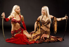 Two young woman sit with saber Royalty Free Stock Photography