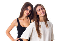 Two young woman standing and smiling Royalty Free Stock Images