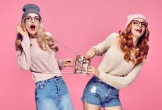 Two Young Woman Surprised Smiling.Having Fun Crazy. Two Young Woman Surprised Smiling. Having Fun Crazy. Fashion. Pretty Sisters Best Friends. Stylish fashion Royalty Free Stock Images