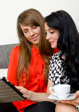 Two young woman with tablet pc Stock Images