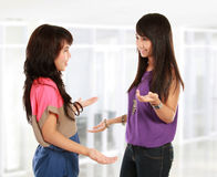 Two young woman talking Stock Photo