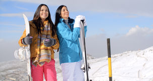 Two young woman with their snowboards Stock Photos