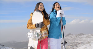 Two young woman with their snowboards Royalty Free Stock Images