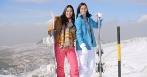 Two young woman with their snowboards Royalty Free Stock Photography