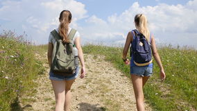 Two young woman walking on mountains stock video footage