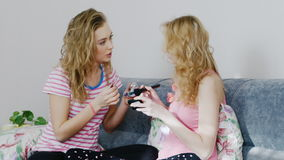 Two young woman watching new cosmetics at home stock video footage