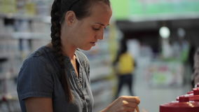 Two young womans choosing spices in grocery section at supermarket. Two young womans have a discussion when choosing spices in grocery section at supermarket stock footage