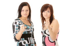 Two young womans pointing Royalty Free Stock Photos