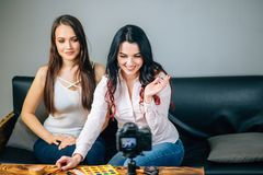 Two young womans reviewing beauty products on video blog at home. Two Beautiful young womans reviewing beauty products on video blog at home Stock Photo