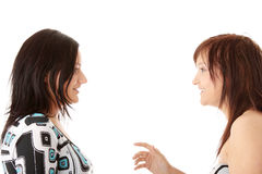Two young womans talking Stock Images