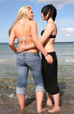 Two young women. Flirting at the beach stock images