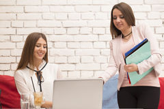Two young women, agents, at a business meeting stock images