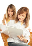 Two young women with an album Stock Photo