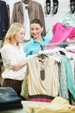 Two Young women at apparel clothes shopping. Two Young women with apparel shirt or blouse during garments clothing shopping at store Stock Photography