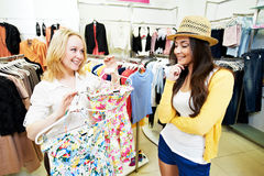 Two Young women at apparel clothes shopping Royalty Free Stock Images