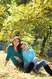 Two young women on autumn background Stock Photography