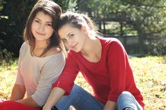 Two young women on autumn background Stock Photo