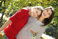 Two young women on autumn background Royalty Free Stock Photography