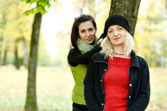Two young women in autumn park Stock Image