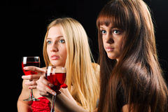 Two young women in a bar. Royalty Free Stock Photography