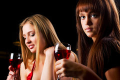 Two young women in a bar. Stock Photos