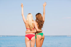 Two young women on beach Stock Photos