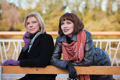 Two young women on a bench Royalty Free Stock Photography
