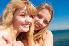 Two women best friends having fun outdoor. Two young women best friends blonde cheerful girls having fun outdoor wind blowing in hair. Summer happiness Royalty Free Stock Photography