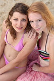 Two young women in bikinis stock photo