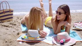 Two young women in bikinis enjoying the beach stock footage