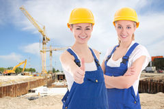 Two young women in blue builder 's uniform Stock Photography