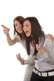 Two young women breaking into laughter. Two young girls to see something very funny and laugh Royalty Free Stock Photos
