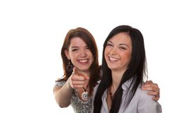 Two young women breaking into laughter. Two young girls to see something very funny and laugh Stock Image