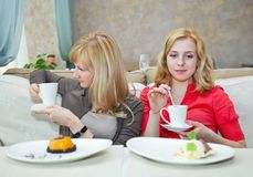 Two young women in cafe Royalty Free Stock Image