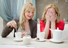 Two young women in cafe Stock Images