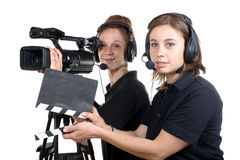 Two young women with  camera Royalty Free Stock Images