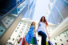 Two Young Women Carrying Shopping Bags Stock Photography