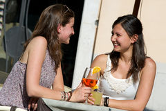 Two Young Women Cheering with Cold Drinks Stock Photography