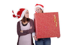 Two young women with christmas present Stock Photo