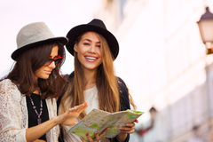 Two young women with city map as tourists Royalty Free Stock Image